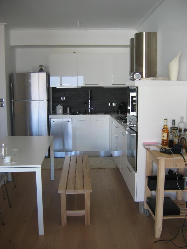 Ανακαίνιση κουζίνας. Inox, black & white Systema di Cucina